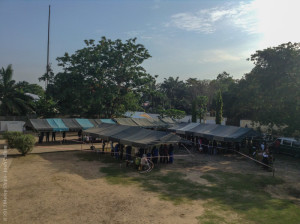 Photo Credit Josh Callow: Screening tents with patients lined up underneath.
