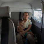 Fitia and her mother on the plane bound for the ship.