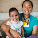 Fitia and her mother wait for her Outpatient appointment