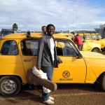 We were greeted at the airport by a dozen or so vintage Renault taxis.  Wenceslas poses in front of the chosen one.