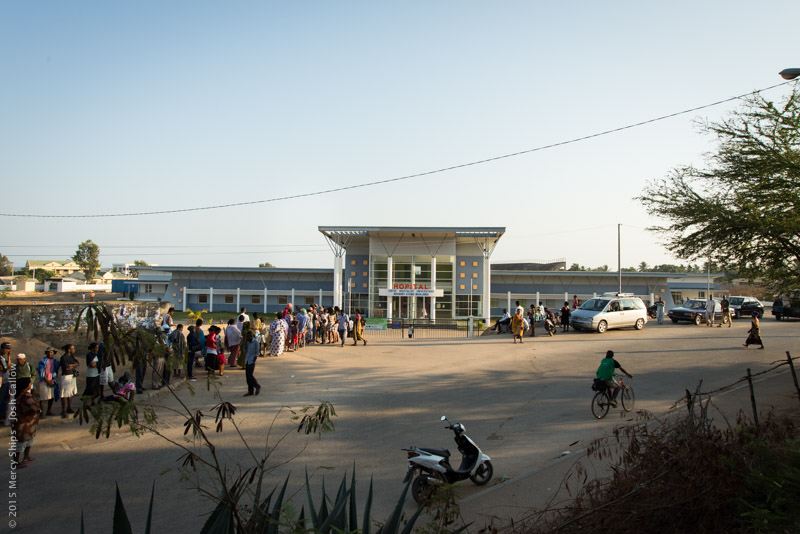 ©2015 Mercy Ships, Photo Credit Josh Callow - Potential patients wait outside Hopital Manara Penitra in Mahajanga to be seen by the screening team. In Mahajanga.